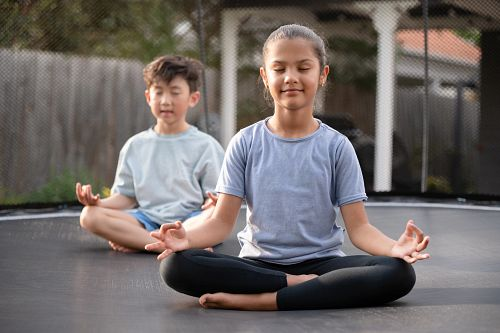 Try a Yoga Seated pose on a Springfree Medium Round Trampoline