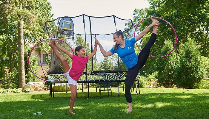 hula hoop games backyard Rosie athlete Springfree Trampoline